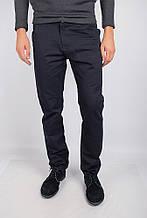 Необычные мужские брюки оригинального кроя с высокой талией и карманами по бокам изумрудный