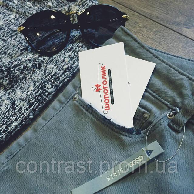 ассортимент недорогой одежды в магазине Shopagolic