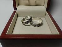Серебряные обручальные кольца знак бесконечность