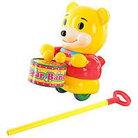 Каталка 1323 (48шт) на палке,медвежонок,при движении играет на барабане,в кульке,20-19-11см