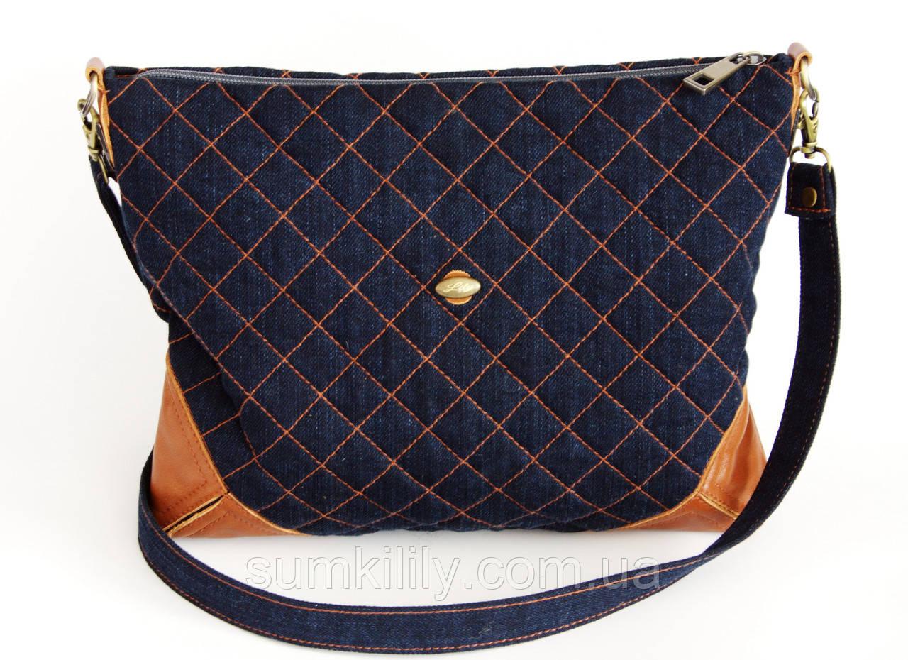 Женская сумочка срыжими кожаными уголками