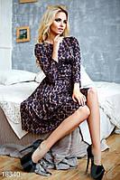 Расклешенное жаккардовое платье. Цвет коричнево-синий.
