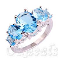 Кольцо с голубым цирконием