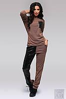 Стильный костюм: кофта и штаны. Кофта с крупным функциональным карманом на груди, декорированным пайетками.