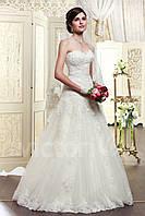 Свадебное платье  без бретелек, с тюля расшито камнями и бесером