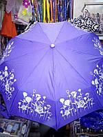 Зонтик на котором проявляются цветы во время дождя