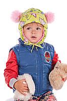 Детская шапка с помпонами