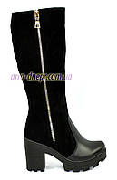 Женские зимние сапоги на устойчивом каблуке, декорированы молнией. Натуральная кожа и замш.