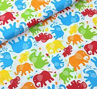 Хлопковая ткань польская слоники цветные оранжево-голубые