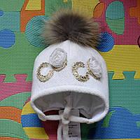 Зимняя шапка с натуральным пампоном из меха енота.