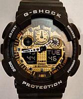 Casio G-Shock GA 100 черный с золотом black gold