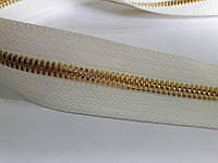 Молния метал. FUTURA рулонная 5мм белый/золото
