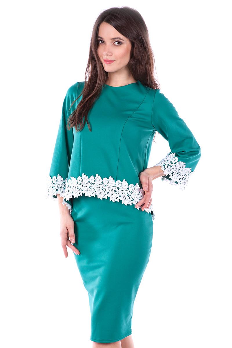 Зеленый костюм женский