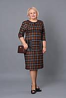 Модное платье с карманами из кожзаменителя и украшением по горловине