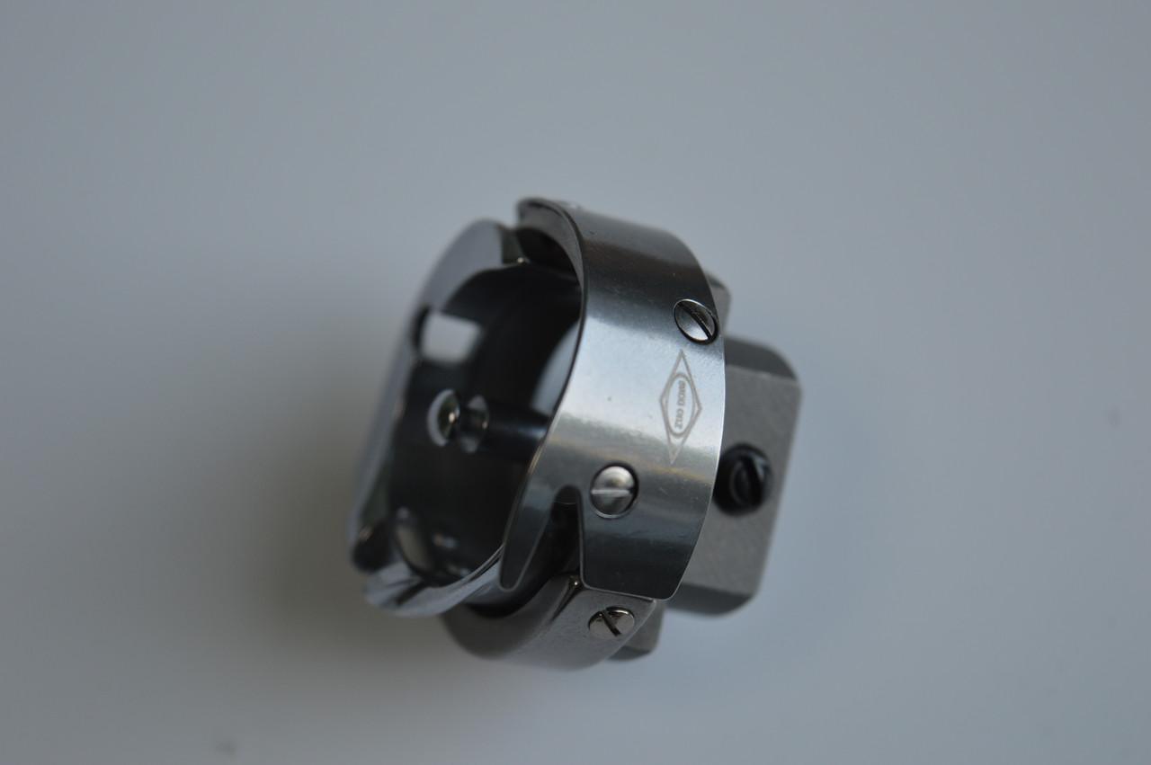 Шпульный колпачек для швейных машин