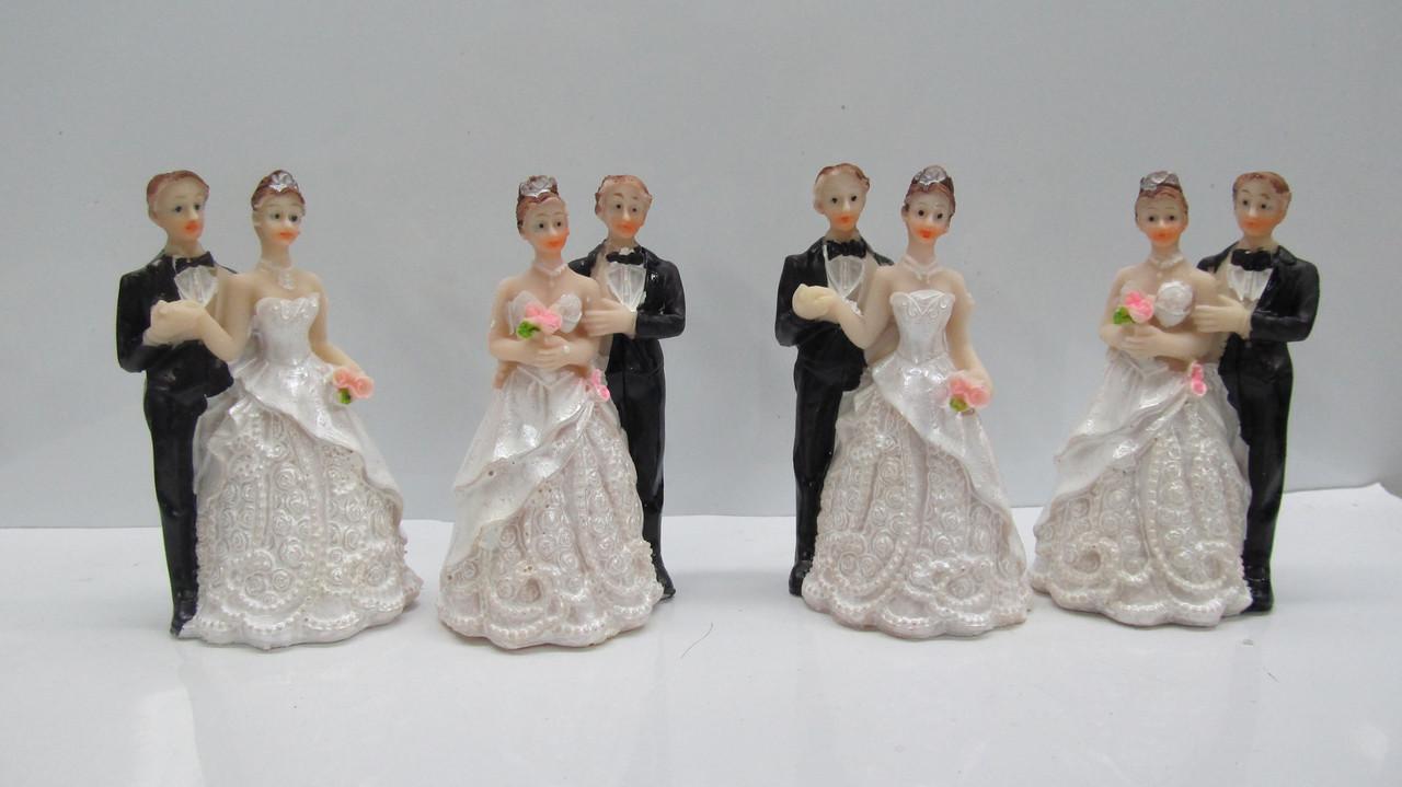 Свадебные фигурки на торт. Высота: 9 см. В упак: 4 шт.
