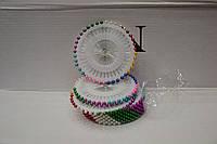Иглы для скрепления ткани перед пошивом с цветными наконечниками.