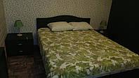 Двуспальная кровать из массива дуба с глухим изголовьем