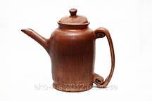 Глиняный чайник для заварки чая.