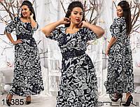 Жаккардовое  платье в пол декорировано кружевом.