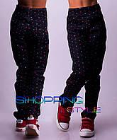 Женские трикотажные брюки в разноцветный горошек