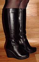 Женские кожаные сапоги на платформе