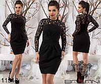 Элегантное женское платье с гипюровым верхом, спереди декорировано складками на талии.