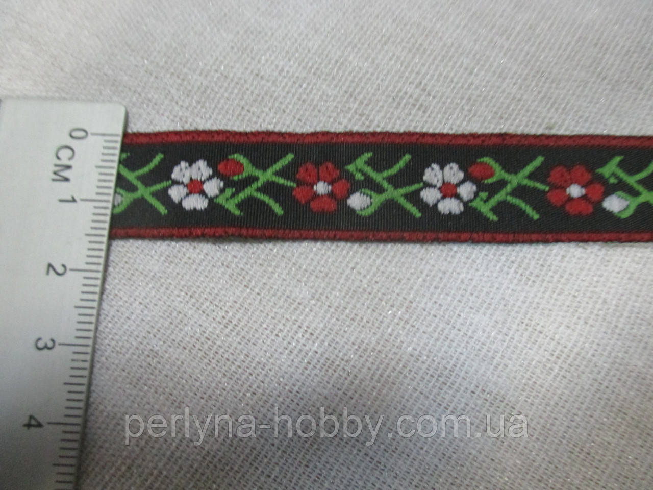 Тесьма з орнаментом квіти 16 мм., чорна з квітами