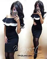 Модное женское платье с воланами