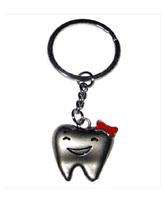 Брелок - зуб девочка