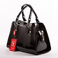 Черная сумочка трапеция в красочном лаке