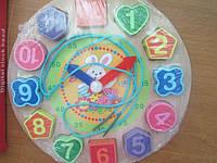 Развивающая игрушка 3 в 1. Часы, вкладыш и шнуровка в одном!