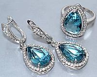 """Набор  """"серьги и кольцо"""",покрытие родием. Камень: белый и бирюзовый циркон. Высота серьги: 4 см Ширина: 15 мм"""