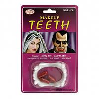 Зубы с капсулами крови