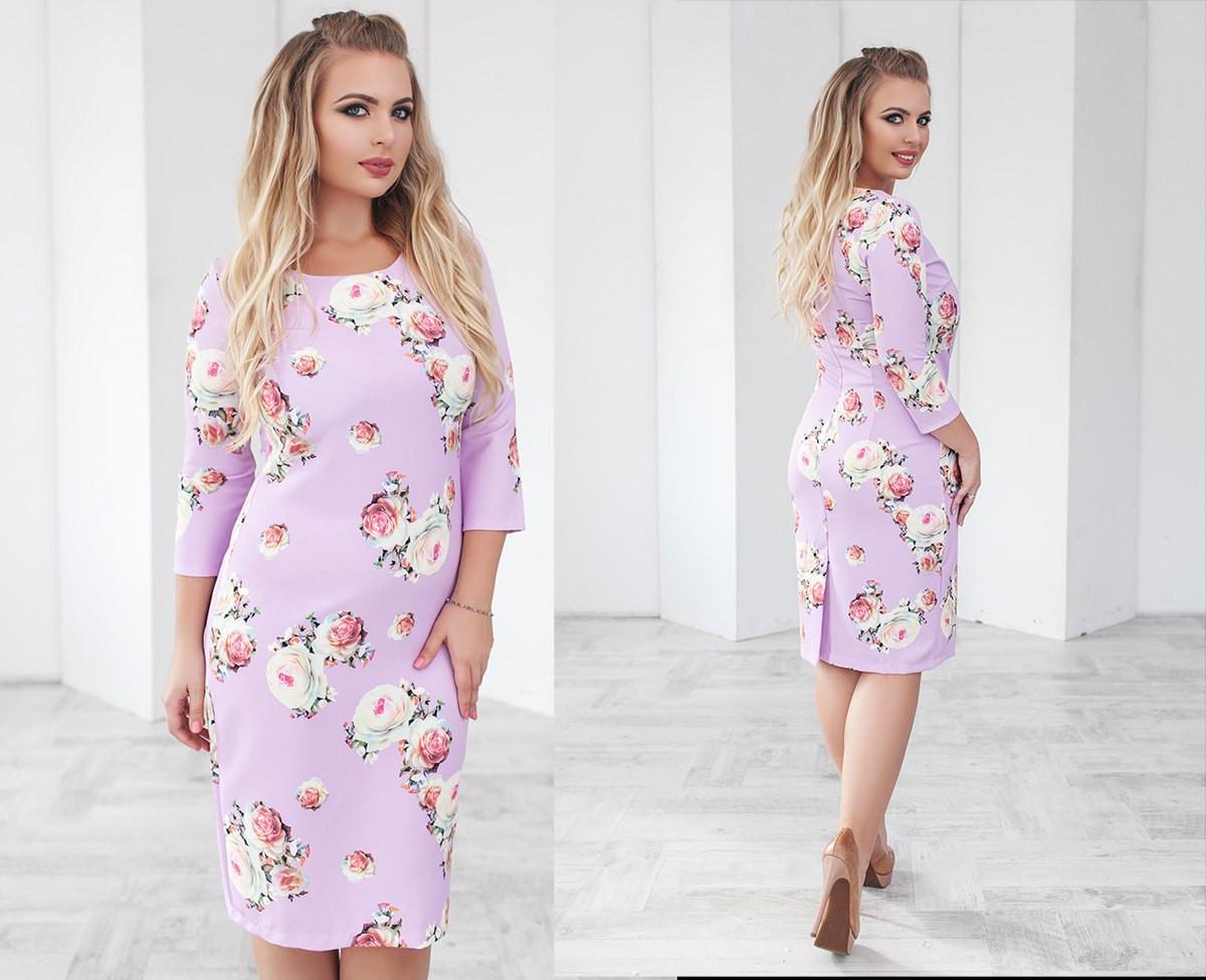 Цвеочное женское платье средней длинны