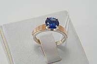 Серебряное кольцо с синим цирконом и золотом