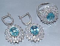 """Набор  """"серьги и кольцо"""",покрытие родием. Камень:белый и голубой циркон. Высота серьги: 3.5 см Ширина: 20 мм"""