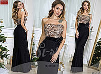 Вечернее платье с легким шлейфом, декорированное оригинальной леопардовой вставкой на груди и брошь на поясе.