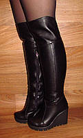 Зимние кожаные ботфорты на платформе