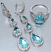 """Набор  """"серьги и кольцо"""",покрытие родием. Камень:белый и бирюзовый циркон. Высота серьги: 6 см Ширина: 12 мм"""