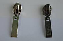 Бігунок декоративний на блискавку виту(спіраль) Т7 з фіксатором