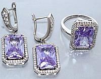 """Набор  """"серьги и кольцо"""",покрытие родием. Камень:белый и сиреневый циркон. Высота серьги: 3,5 см Ширина: 15 мм"""