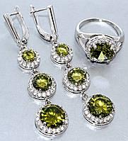 """Набор  """"серьги и кольцо"""",покрытие родием. Камень:белый и оливковый циркон. Высота серьги: 6 см Ширина: 14 мм 18"""
