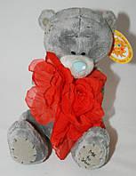 Мишка Тедди с цветком