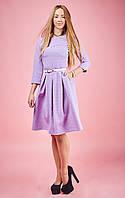 Расклешенное платье сиреневого цвета