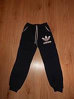 Теплые спортивные брюки на мальчика тринитка примерно 6,7,8 лет