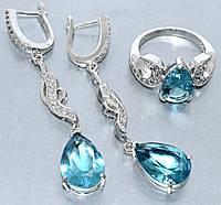 """Набор  """"серьги и кольцо"""",покрытие родием. Камень:белый и голубой циркон. Высота серьги: 5,5см Ширина:10мм 18р."""