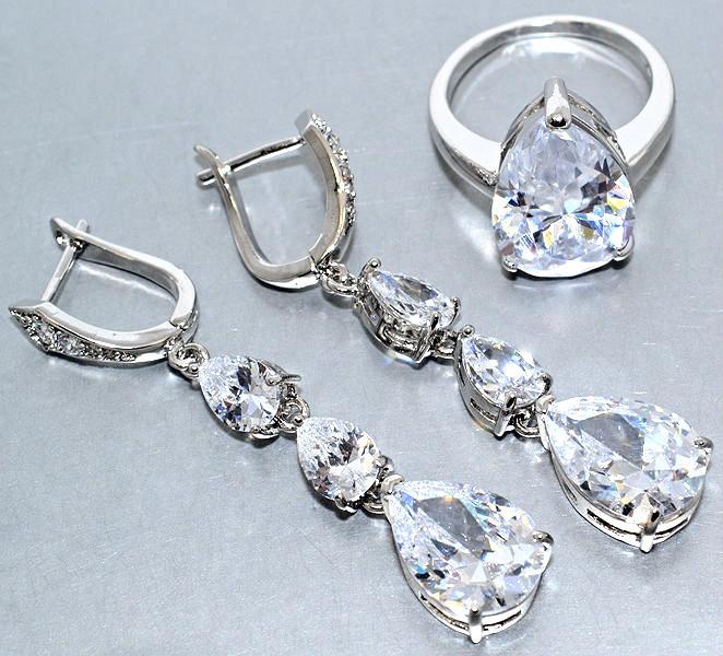 """Набор  """"серьги и кольцо 18 р."""",покрытие родием. Камень:белый циркон. Высота серьги: 5 см Ширина: 10 мм."""