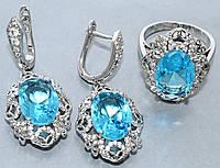 """Набор  """"серьги и кольцо"""",покрытие родием. Камень:белый и голубой циркон. Высота серьги: 4 см Ширина: 19 мм"""