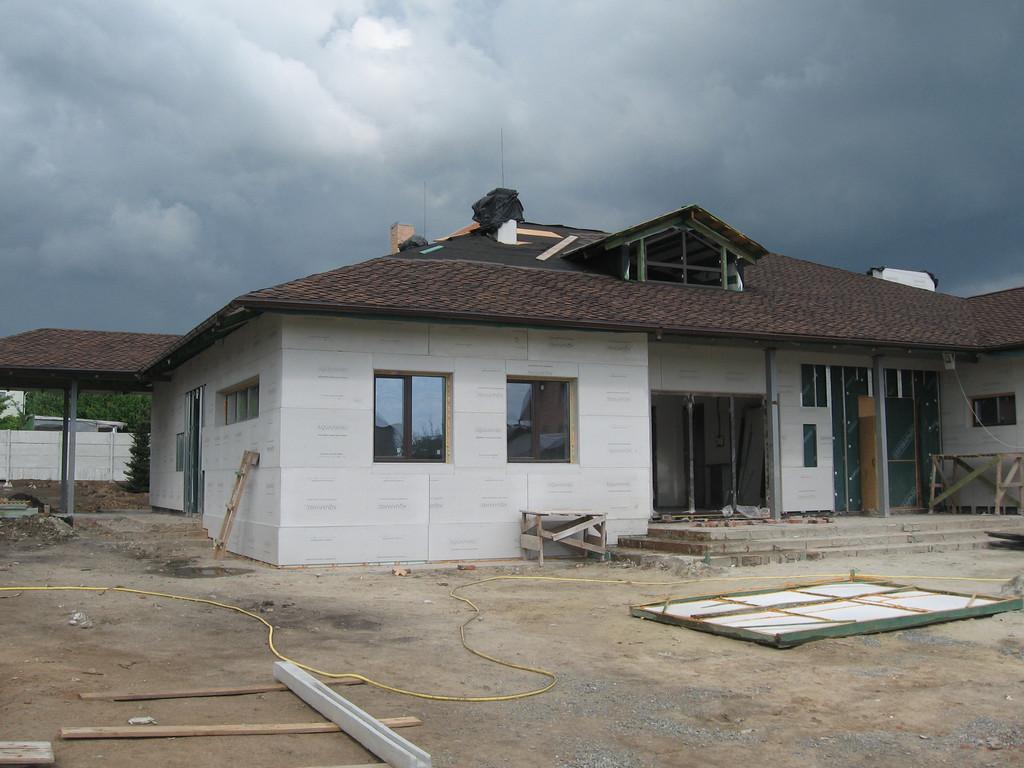 Облицовка травертином фасада частного дома 5